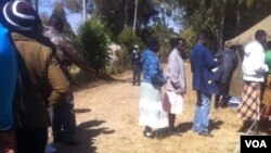 Voters captured recently waiting to cast their ballots in the Zimbabwe general election won by President Robert Mugabe's Zanu PF
