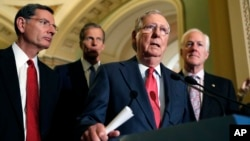 From left, Sen. John Barrasso, R-Wyo., Sen. John Thune, R-S.D., Senate Majority Leader Mitch McConnell of Ky., and Senate Majority Whip John Cornyn of Texas, participate in a news conference on Capitol Hill in Washington, Nov. 16, 2016.
