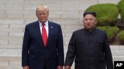 Predsednik SAD Donald Tramp i severnokorejski lider Kim Džong Un