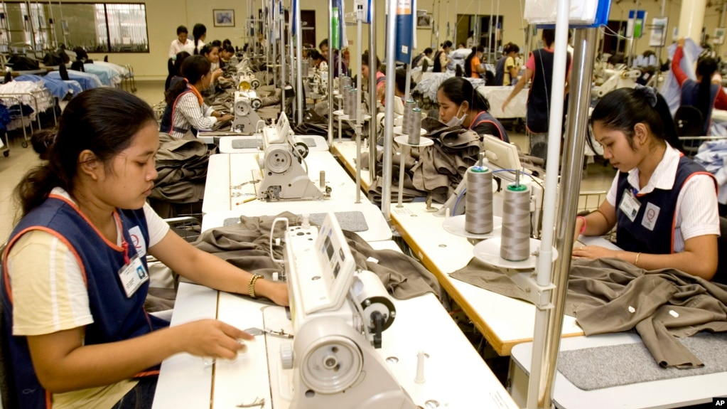 FILE PHOTO - Cambodian garment workers sew clothes in a factory in Phnom Penh, Cambodia, Aug. 4, 2007. (AP Photo/Heng Sinith)