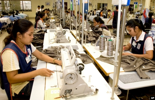 FILE - Cambodian garment workers sew clothes in a factory in Phnom Penh, Cambodia, Aug. 4, 2007.