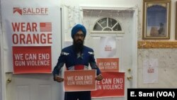 Vishavjit Singh, who dresses up as Sikh Captain America, poses to speak out against gun violence.