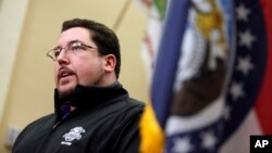 Ferguson, Mo., Mayor James Knowles, shown announcing the resignation of Police Chief Thomas Jackson at news conference on March 11, says it will up to voters to remove him from the part-time job.