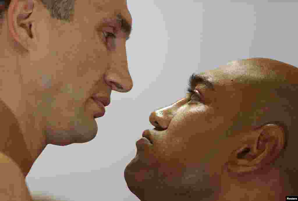 Heavyweight boxing world champion Vladimir Klitschko of Ukraine faces Axel Leapai of Australia (R) after the official weigh-in in the western city of Muelheim, Germany. Klitschko will be facing Leapei in a title match on April 26.