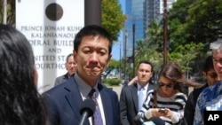 FILE - Hawaii Attorney General Douglas Chin speaks outside federal court in Honolulu, March 29, 2017.