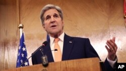 FILE - Secretary of State John Kerry is shown at a news conference in Amman, Jordan, Feb. 21, 2016. The secretary is seeking more information before determining whether atrocities committed by Islamic State constitute genocide.