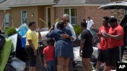 President Barack Obama greets residents as he tours Castle Place, a flood-damaged area of Baton Rouge, Louisiana, Tuesday, Aug. 23, 2016. (AP Photo/Susan Walsh)