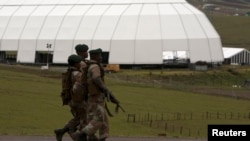 Soldiers patrol on the edge of the property of Nelson Mandela in Qunu, Eastern Cape, Dec. 12, 2013.