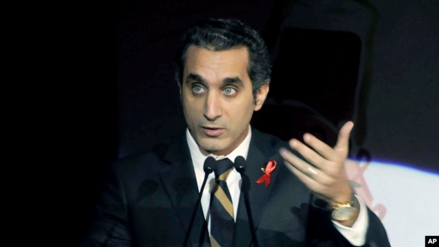 Egyptian TV host Bassem Youssef addresses attendants at a gala dinner party in Cairo, Dec. 8, 2013.