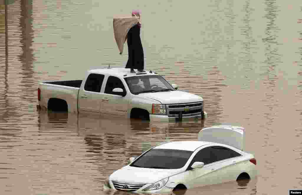 Cars are partially submerged in floodwater following heavy rains in Riyadh, Saudi Arabia.