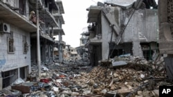Savaştan önce 200 bin kişinin yaşadığı Kobani, IŞİD'in çekilmesinden sonra enkaz yığını haline geldi