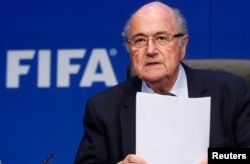FILE - Re-elected FIFA President Sepp Blatter arrives for a news conference after an extraordinary Executive Committee meeting in Zurich, Switzerland, May 30, 2015.