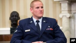 FILE - Air Force Airman 1st Class Spencer Stone sits in the Oval Office of the White House during a meeting with President Barack Obama in Washington, Sept. 17, 2015.
