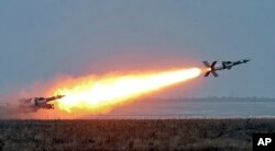 FILE - In this photo released by the Ukrainian National Security and Defense Council, an anti-aircraft rocket system is tested at a military training ground Odessa region, Ukraine, Dec. 5, 2018. The Ukrainian military has been on increased readiness as part of martial law introduced in the country in the wake of the Nov. 25, 2018, incident in the Sea of Azov, in which the Russian coast guard fired upon and seized three Ukrainian navy vessels along with their crews.