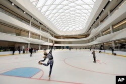 Sabrina Piliero, with World Ice Events, practices on the rink at the American Dream mega entertainment and shopping complex in East Rutherford, N.J., Friday, Oct. 25, 2019. (AP Photo/Richard Drew)