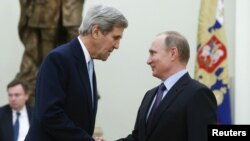 FILE - Russian President Vladimir Putin (R) welcomes U.S. Secretary of State John Kerry during a meeting at the Kremlin in Moscow, Russia Dec. 15, 2015.
