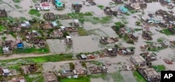 This image made available by International Federation of Red Cross and Red Crescent Societies (IFRC) on Monday March 18, 2019, shows an aerial view from a helicopter of flooding in Beira, Mozambique.
