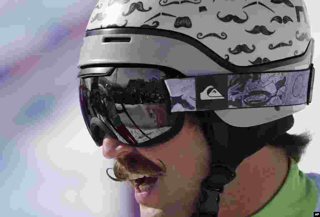 Slovenia's Filip Flisar wears his distinctive moustache helmet during men's ski cross competition at the Rosa Khutor Extreme Park, Krasnaya Polyana, Russia, Feb. 20, 2014.