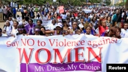 Kenyan women take part in a protest in Nairobi, Nov. 17, 2014, to demand justice for a woman who was recently attacked and stripped in Nairobi by men who claimed she was dressed indecently.