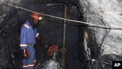 A Zimbabwean miner works underground at Metallon Gold mine, country's largest gold miner, in Shamva about 80 km (50 miles) north of the capital Harare, June 14, 2011.