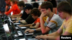 FILE - Visitors at the Games Convention Online 2009 fair in the eastern German city of Leipzig July 31, 2009. (REUTERS/Fabrizio Bensch)