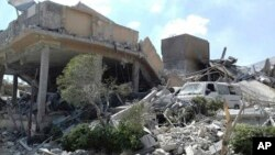 FILE - In this photo released by the Syrian official news agency SANA, shows the damage of the Syrian Scientific Research Center which was attacked by U.S., British and French military strikes to punish President Bashar Assad for suspected chemical attack
