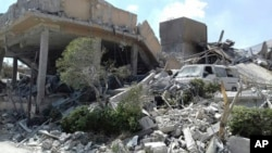 This photo released by the Syrian official news agency SANA, shows the damage of the Syrian Scientific Research Center on Saturday, April 14, 2018. Russia's military said Syrian air defense units downed 71 out of 103 cruise missiles launched by the U.S. and its allies. (SANA via AP)
