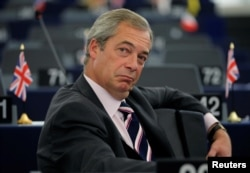 FILE - Nigel Farage waits for the start of a debate on the last European Summit at the European Parliament in Strasbourg, France, Oct. 26, 2016.