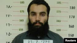 FILE - Anas Haqqani, a senior leader of the Haqqani network, arrested by the Afghan Intelligence Service (NDS) in Khost province is seen in this handout picture released Oct. 16, 2014.