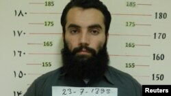 FILE - Anas Haqqani, a senior leader of the Haqqani network, arrested by the Afghan Intelligence Service (NDS) in Khost province is seen in this handout picture released October 16, 2014.