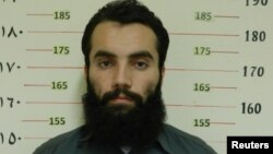 Anas Haqqani, a senior leader of the Haqqani network, arrested by the Afghan Intelligence Service (NDS) in Khost province is seen in this handout picture released Oct. 16, 2014.