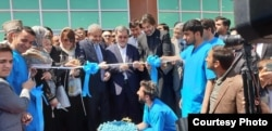 The ribbon-cutting is shown for the Muhammad Ali Jinnah Hospital in Kabul, one of three major health care facilities being built and funded by Islamabad as its contribution to reconstruction efforts in war-ravaged Afghanistan.