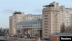 """A view of the so-called """"House on the Embankment"""" building, with the Teatr Estrady (Variety Theatre) seen in it, in central Moscow, March 9, 2016."""