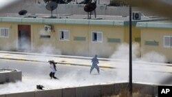 Libyan rebels continue to fight inside Moammar Gadhafi's compound Bab al-Aziziya in Tripoli, Libya, early Wednesday, August 24, 2011
