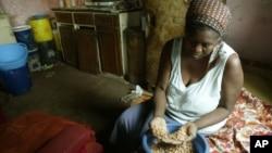 FILE: Faustine Janjira prepares food at her home in Highfields, a high density surburb in Harare, Tuesday, Oct, 17, 2006. (AP Photo/Tsvangirayi Mukwazhi)