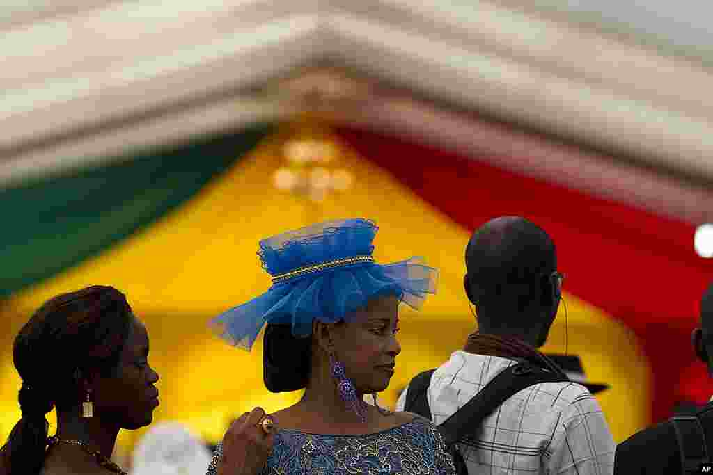 Guests arrive to attend the inauguration of President-elect Macky Sall, at a hotel in Dakar. (AP)