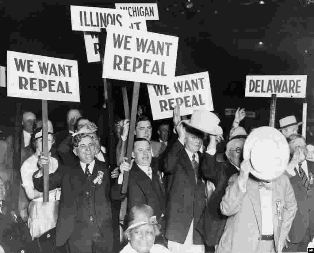 FILE - Carrying placards urging repeal of the 20-year provision for payout, Bonus Army vets unleash their first major demonstration at the Republican National Convention in Chicago, Ill., June 15, 1932. Herbert Hoover and Charles Curtis were nominated as presidential and vice presidential candidates, respectively.