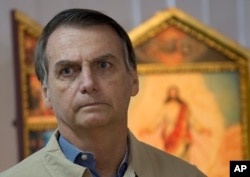 FILE - Presidential candidate Jair Bolsonaro is pictured during a meeting with Rio de Janeiro's Archbishop Dom Orani Tempesta in Rio de Janeiro, Brazil, Oct. 17, 2018.