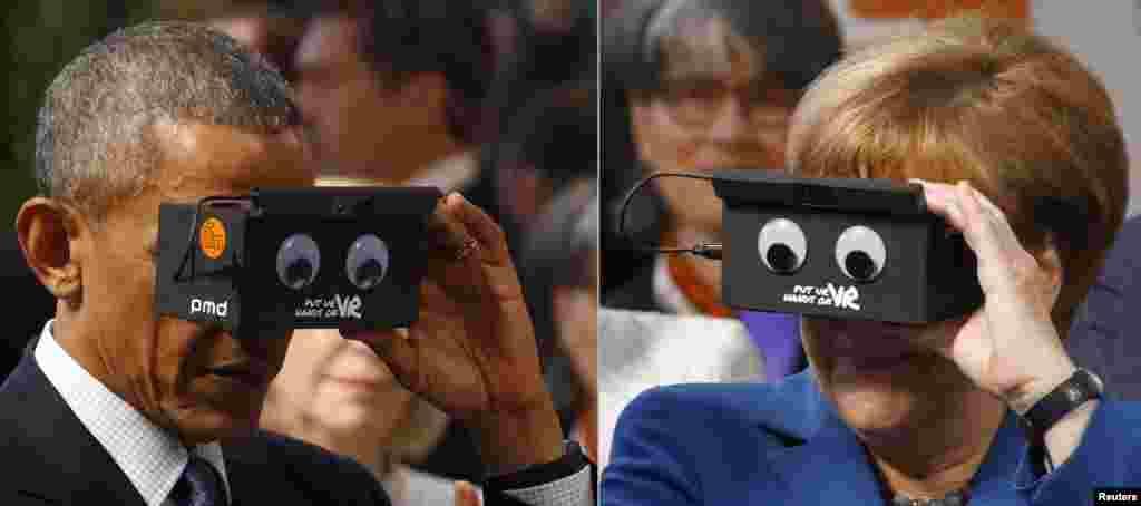 باراک اوباما رئیس جمهوری آمریکا و آنگلا مرکل صدر اعظم آلمان در نمایشگاه بزرگ صنعت و تکنولوژی هانوفر دوربین واقعیت مجازی را امتحان می کنند.