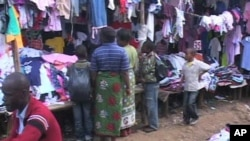 Shoppers look for second-hand clothing called 'mitumba' at Toi Market in Nairobi, Kenya
