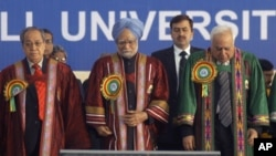 In this 2009 file photo, Indian Prime Minister Manmohan Singh is shown listening to the national anthem at the inaugural function of 96th Indian Science Congress association at North Eastern Hill University at Shillong in Meghalaya, India.