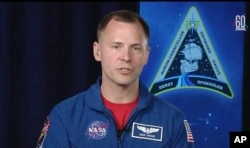 In this frame from video from NASA TV, NASA astronaut Nick Hague, who survived the Oct. 11, 2018, failed launch and emergency landing, speaks from the NASA Johnson Space Center in Houston, Oct. 16, 2018.