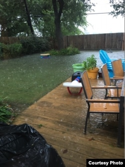 Floodwaters rise to meet the deck in the backyard of a home in the Westbury neighborhood of Houston, Aug. 27, 2017. (Photo courtesy of Paul Trinh)