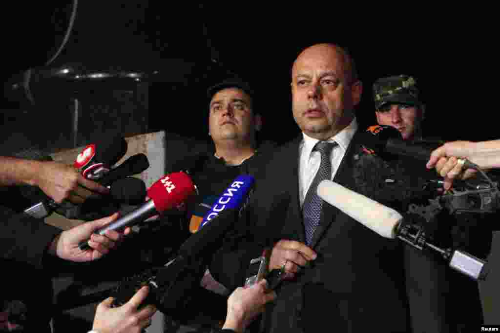 Ukrainian Energy Minister Yuri Prodan talks to journalists as he leaves after talks with members of the Russian delegation and EU Energy Commissioner Guenther Oettinger (not pictured), June 16, 2014.