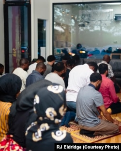 Attendees at the first Black Iftar event, held in Chicago, breaking for prayer.