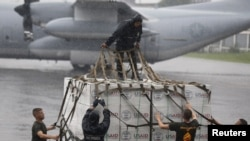 U.S. and Philippine military personnel prepare boxes containing tent material from U.S. relief organisation USAID to be deployed by airlift to the victims of super typhoon Haiyan, at a Manila airport November 13, 2013. Philippine officials have been overw