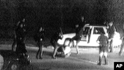 This video image shows police officers beating a black driver named Rodney King. The 1991 event helped start one of the worst race riots in American history.