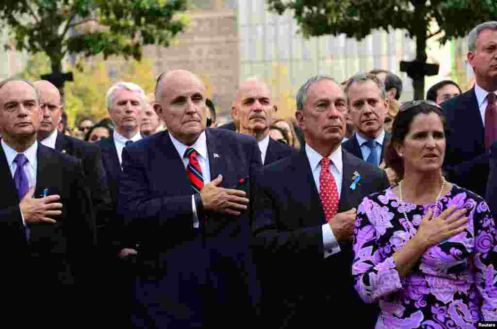 Former Mayor Rudy Giuliani (2nd L) and New York City Mayor Michael Bloomberg (2nd R) attend a ceremony at the 9/11 Memorial marking the 12th anniversary of the attacks on the World Trade Center in New York September 11, 2013.