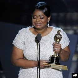 "Octavia Spencer accepts the Oscar for best actress in a supporting role for ""The Help"" during the 84th Academy Awards on Sunday, Feb. 26, 2012, in the Hollywood section of Los Angeles."