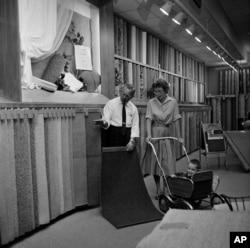 d14168966c3 A customer examines carpet samples at Sears Roebuck department store in  Niles
